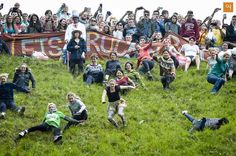 Cooper's Hill Cheese-Rolling and Wake, England ; This is an unusual festival where a 9 lb round of Double Gloucester Cheese is rolled down a hill and competitors race down after it.