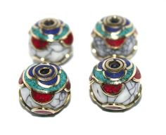 These are Handmade beads.    (FOUR BEADS)   Metal = Brass   Stone =coral, Lapis…