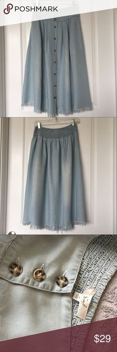 Boho Skirt On Trend Smock Waist Frayed Hem! Beautiful soft blue distressed chambray, easy fit, drapes nicely. Purchased from local boutique, worn once, so like new. Wear now with tee and sandals, later with sweater and booties. Perfect early Fall addition to your wardrobe. Easel Skirts Midi