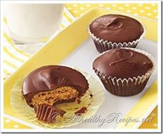 Homemade Peanut Butter Cups  _ A simple but decadent confection that quells the urge to dip your chocolate bars in the peanut butter. These Peanut Butter Cups have a shell of milk chocolate and semi sweet chocolates and a smooth and creamy peanut butter center.