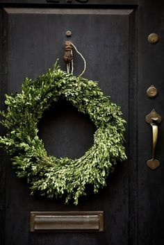 Love this wreath on that black door from Habitually Chic