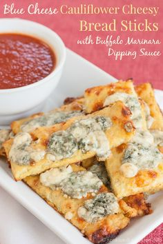 Blue Cheese Cauliflower Cheesy Bread Sticks with Buffalo Marinara Dipping Sauce - a crispy, gooey, spicy appetizer recipe that's packed with flavor AND veggies. You'll never miss the carbs! | cupcakesandkalechips.com | gluten free, low carb