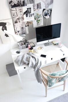 Bright and cozy Scandinavian home office with lots of personality from the photo board above it.