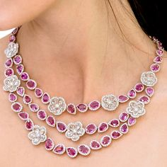 This pink sapphire necklace from Avakian sees three irregular strands of pink sapphires interspersed with rose-cut diamonds formed into flower shapes. The necklace has 31 carats of diamonds and 77 carats of pink sapphires, and has matching earrings. Discover the jewellery house from Geneva give fashion a playful spin: http://www.thejewelleryeditor.com/videos/fine-jewellery/house-of-fun-avakian-the-most-playful-jeweller-in-geneva/?action=play #jewelry