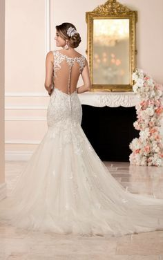 Dress Spotlight! This designer fit and flare wedding dress from Stella York features a figure-flattering fitted bodice that flares just below the hips into a full tulle skirt. Sparkling beading throughout catches the eye, while the low-cut illusion back makes for an elegant exit. The back zips up with ease under fabric-covered buttons. #SoStella