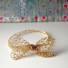 Easy to make Crochet Bow Bracelet. All you need is your crochet hook a thin flexible wire.