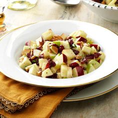 Cinnamon Apple-Nut Salad Recipe- Recipes  This sensational apple salad features lots of color, taste and texture. But don't wait for a party to enjoy it—treat your clan to this refreshing and tasty delight on weeknights, too. The cinnamon in the dressing is a fantastic accent to the crisp apples.