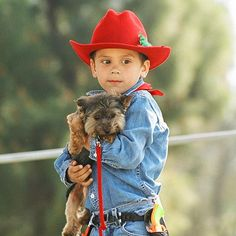 Just a boy and his dog, and his hat, and his holster, prolly boots too...lol