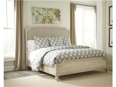 Shop for Signature Design King/Cal King UPH Panel HDBD, B693-78, and other Bedroom Beds at Woodstock Furniture in Acworth and Hiram Georgia. With the rustic beauty of the gently distressed parchment white finish perfectly highlighting the elegant look of the shaped fronts and framed pilaster mouldings, the Demarlos bedroom collection features large scaled headboard frames surrounding the nicely crowned textured upholstered cushion with bands and nail accent to complete the Vintage Casual ...