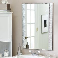 I wonder if the hammered-type inlay on the sides would help blend all the various metal finishes in the powder room?...  Eitherway, it's an interesting detail that isn't too polarizing