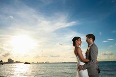 Bride and groom sunset beach portraits in Puerto Cancun, Mexico. Magic Art Wedding Studio
