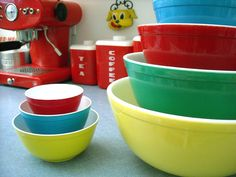 Vintage Pyrex mixing bowls and child's set of the same. & lustroware in the background...