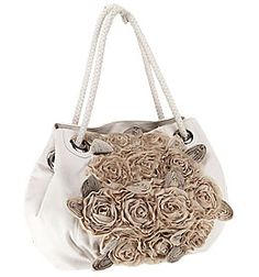 Nicole Lee handbags.. I love her bags.. I have several...