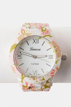 """Wear+the+spring+season+on+your+wrist+with+the+Garden+Grove+Floral+Watch.+This+watch+features+a+watercolor+floral+print+allover.+Pair+with+a+lace+top+and+satchel!<br><br>    -.75""""+band+width<br>  -1.5""""+diameter+(face)+<br>  -Battery+operated<br>  -Twist+crown+to+set<br>  -Imported<br>"""