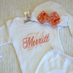 Layette Gown and Infant Hat. Light Pink and Pink Monogramming with Pink Bow on Hat.. $38.99, via Etsy.