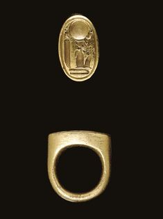 AN EGYPTIAN GOLD STIRRUP RING   New Kingdom, Dynasty XVIII,1353-1335 B.C. The massive stirrup-shaped ring cast with a plain hoop, rounded on the interior and exterior, rising to the high shoulders, the bezel with a scene of a solar disk flanked by cobras, each wearing the White Crown of Upper Egypt, the seated figure of Akhenaten below wearing the Red Crown of Lower Egypt fronted by a uraeus,