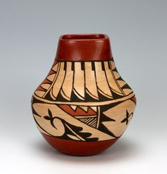 It has a cream colored slip with a stone polished finish and traditional designs painted around it! The top & bottom has a red slip with a stone polished finish and Juanita's trademark lightning design on the inside of the rim! Pottery Sculpture, Pottery Vase, Ceramic Pottery, Native American Pottery, Native American Indians, Pueblo Native Americans, Southwest Pottery, Pueblo Pottery, Wedding Vases