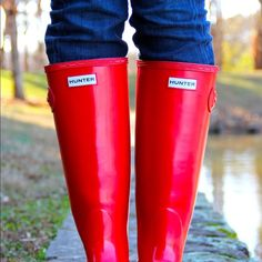 Shiny Red Hunter Rainboots Used shiny red Hunter Rainboots. Tall and comes to your knees. Fits well and has normal wear. Hunter Boots Shoes Winter & Rain Boots