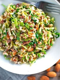 Bacon and Brussel Sprout Salad - Pinch of Yum - - This bacon and brussel sprout salad is so good! Thinly sliced brussel sprouts, crumbled bacon, Parmesan, almonds, and shallot citrus dressing. Paleo Recipes, Yummy Recipes, Cooking Recipes, Recipies, Crafting Recipes, Dinner Recipes, Bacon Recipes, Rice Recipes, Cooking Tips