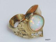 Opalschmuck, Opalring aus Gold (Gelbgold) mit Kristallopal