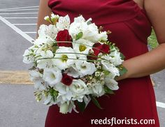 Beautiful Bridesmaid's Bouquet perfectly compliments her stunning red dress. Flowers by www.reedsflorists.com Bridesmaid Bouquet, Compliments, Floral Wreath, Wreaths, Cute, Party, Flowers, Red, Wedding