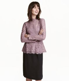 Heather purple. Fitted lace top with a small stand-up collar, long sleeves, and a gently flared peplum with pleats at front and back. Camisole liner top in