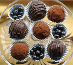 Chocolate Coffee Truffles. Made with chocolate chips, cream cheese, instant coffee, water, and dark chocolate candy coating (or cocoa for rolling).