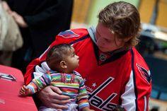 Washington's Nicklas Backstrom meeting a young fan.