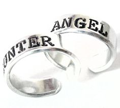 """The perfect rings for you and an equally-obsessed Supernatural buddy, soulmate, companion...these bright, pure aluminum rings have been hand stamped with """"Angel"""" and """"Hunter"""" in our Typewriter Caps fo"""