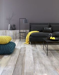 Wide plank grey floors - similar to the floors at the passport office (they may have been long linoleum tiles that looked like wood) by kelli