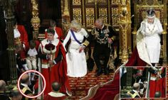 One of the Queen's page boys dramatically collapsed the middle of her speech to British politicians and peers. Witnesses described hearing a 'loud thud' as a young member of the procession fell to the floor to the right of the throne. Prince Charles and Camilla looked on with concern as footmen rushed to the boy's aid, before apparently carrying him out of the Lords chamber. June 4, 2014.