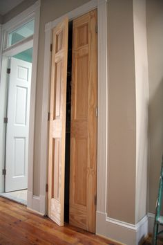 "DIY ""french doors"" on a closet - single solid wood door cut in half"