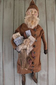 This guy is a wonderful hanging Santa. You can get him in this tan or aged cream color flannel. Wonderful details on this guy ! Primitive Country Christmas, Primitive Santa, Antique Christmas, Primitive Crafts, Primitive Christmas, Rustic Christmas, Primitive Pumpkin, Primitive Doll, Father Christmas