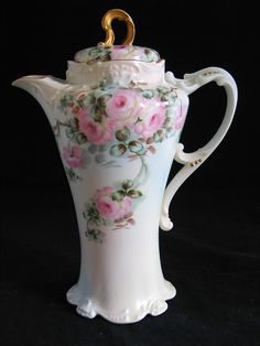 Would Love to have this Teapot. This is posted as a tea pot but after looking at so many tea and cocoa pots, I think this looks more like a cocoa pot. Pretty no matter what it's name is.