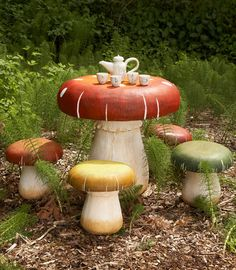 Toadstool Table & Chairs Set  We love the mushroom shape and detailing on the table and chairs. This set is made of resin and can be used indoors and out. All of this whimsical charm comes at a steep price - $450.00