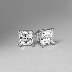 princess cut diamond stud earrings.