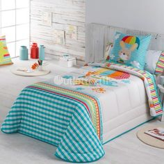 Colcha Bouti GLOBUS de la firma Tejidos JVR. Aparece un conejito viajando felizmente en globo junto a sus amigos. Reinan los tonos azul cielo con algún toque de naranja. Una bonita idea para vestir la cama de los niños.