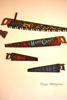 handpainted saws found on Flickr by Best Dressed Signs.
