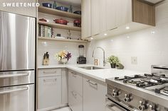 Chelsea kitchen features neutral white backsplash tile from Nemo Tile, Bertazzoni range, Bosch dishwasher concealed with custom door panel, and Samsung fridge.