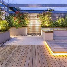 When designing your backyard, don't forget to carefully plan your lighting as well. Get great ideas for your backyard oasis here with our landscape lighting design ideas. Roof Terrace Design, Rooftop Design, Modern Backyard Design, Fence Lighting, Backyard Lighting, Lighting Ideas, Rooftop Lighting, Terrasse Design, Landscape Lighting Design