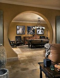 Man cave hobbit hole-this rounded entry to the billiard room is so different and just cool.