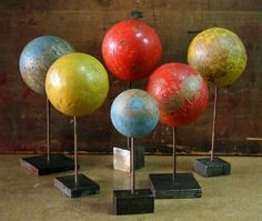 hat stands- would be even better if these were globes.