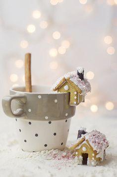 Mini gingerbread house cookies on the rim of a mug of hot chocolate ❤️