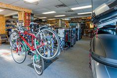 Inside Rack N Road Seattle, WA showing off our Thule bike rack systems
