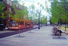 Tramway and generous sidewalk alongside Jamison Square in Portland, Oregon. Click image for link to project details and visit the slowottawa.ca boards >> https://www.pinterest.com/slowottawa/boards/
