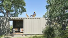 Two Shipping Containers Fuse Into Off Grid Nature Getaway