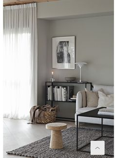 Soft grey walls and diffused light in a minimalist living room. Love the thin framed black shelving unit and how it connects with the thin framed square coffee table. wall Beige and grey in the living room Chic Living Room, Living Room Modern, Living Room Designs, Living Room Decor Grey Walls, Kitchen Living, Small Living, Beige And Grey Living Room, Beige Room, Minimalist Living