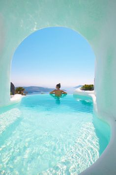 Whitewashed Interiors and Envy-Inducing Pools at Dana Villas in Santorini : Cave pool in Santorini A stunning collection of whitewashed suites and envy-induced pools, Dana Villas will fulfill everyone's dream vacation in Santorini. Dana Villas Santorini, Santorini Travel, Santorini Honeymoon, Santorini House, Greece Honeymoon, Honeymoon Hotels, Dream Vacations, Vacation Spots, Jamaica Vacation