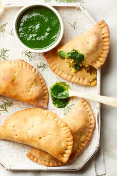 Empanadas are wonderful for entertaining because the deliciously flaky turnovers are easy to serve and can be eaten out of hand—no silverware required. These vegan empanadas are stuffed with a spicy mashed potato-chickpea combination and paired with a bright green spinach sauce that can be either drizzled over the empanadas or served in a bowl for dipping....