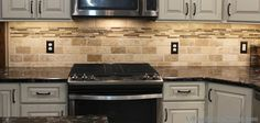 Tumbled Travertine Tile Backsplash With Accent Strip Diy Kitchen Storage, Diy Kitchen Cabinets, Kitchen Redo, Kitchen Flooring, Kitchen Backsplash, Kitchen Remodel, Kitchen Renovations, Travertine Tile Backsplash, Vinyl Backsplash